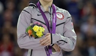 U.S. silver medallist gymnast McKayla Maroney gestures during the podium ceremony for the artistic gymnastics women's vault finals at the 2012 Summer Olympics, Sunday, Aug. 5, 2012, in London.  (AP Photo/Julie Jacobson)