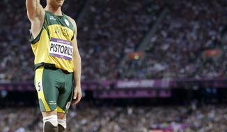 South Africa's Oscar Pistorius waves after running in the men's 400-meter semifinal during the athletics in the Olympic Stadium at the 2012 Summer Olympics, London, Sunday, Aug. 5, 2012. (AP Photo/Anja Niedringhaus)