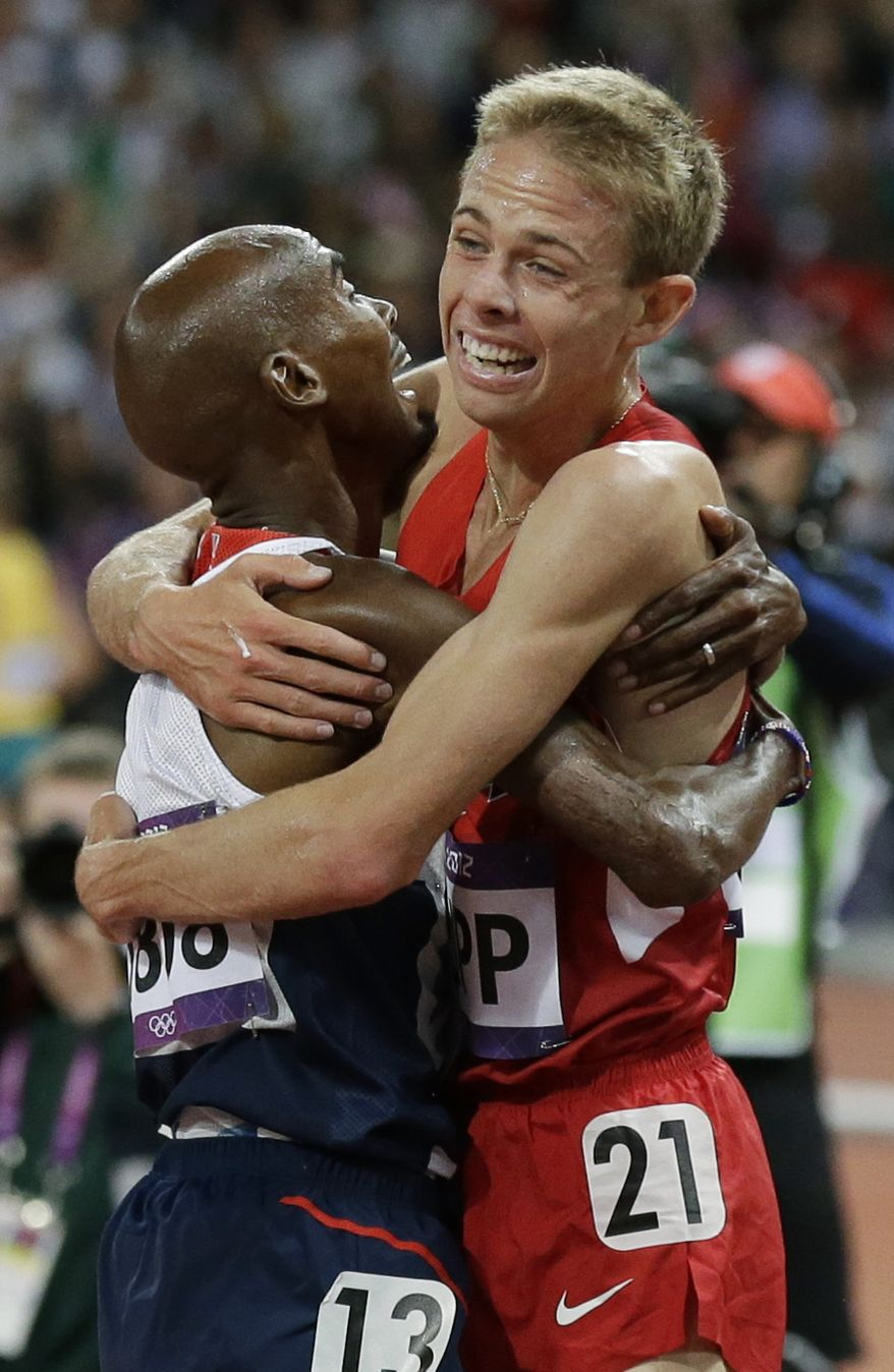 Britain's Mo Farah, left, and United States' Galen Rupp react after the men's 10,000-meter run during athletics competition in the Olympic Stadium at the 2012 Summer Olympics, Saturday, Aug. 4, 2012, in London.  (AP Photo/Rebecca Blackwell)
