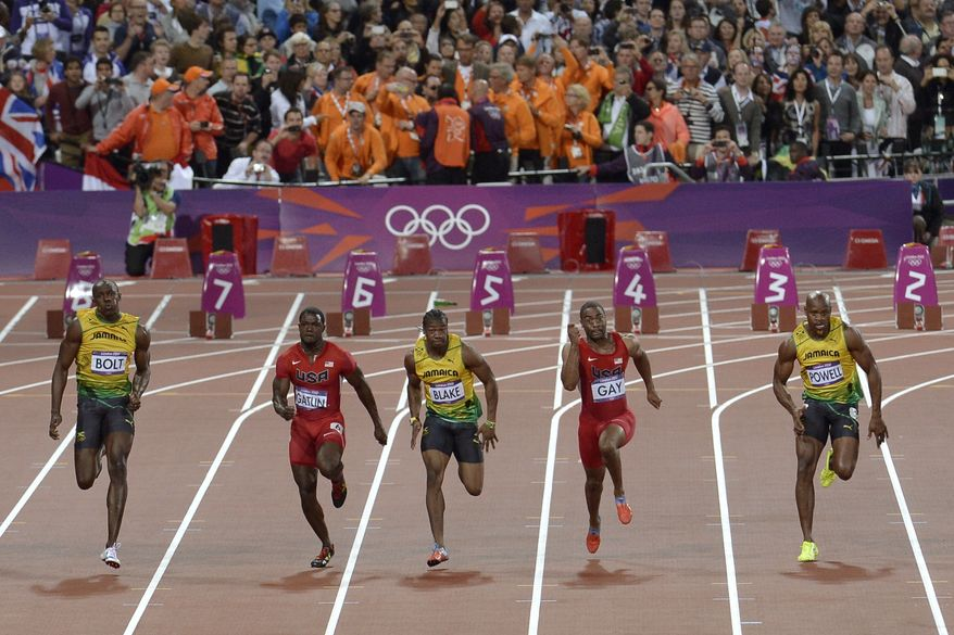 A bottle lies on the track behind the starting blocks after being thrown from the crowd as, from left, Jamaica's Usain Bolt, United States' Justin Gatlin, Jamaica's Yohan Blake, United States' Tyson Gay and Jamaica's Asafa Powell compete in the men's 100-meter final the athletics in the Olympic Stadium at the 2012 Summer Olympics, London, Sunday, Aug. 5, 2012. (AP Photo/Martin Meissner)