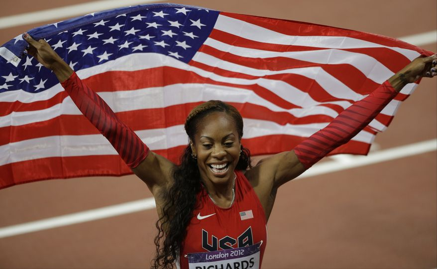 Sanya Richards-Ross of the US waves the national flag after winning a gold medal in the women's 400-meter race during the athletics competition in the Olympic Stadium at the 2012 Summer Olympics, London, Sunday, Aug. 5, 2012. (AP Photo/Matt Slocum)