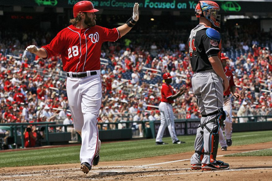 Washington Nationals' Jayson Werth scores on a two-RBI single by Stephen Strasburg during the second inning of a baseball game with the Miami Marlins, Sunday, Aug. 5, 2012, in Washington. The Nationals won 4-1. (AP Photo/Alex Brandon)