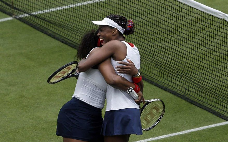 United States' Serena Williams, left, celebrates with partner Venus Williams, right, after defeating Czech Republic's Lucie Hradecka and Andrea Hlavackova in a women's doubles gold medal tennis match at the All England Lawn Tennis Club at Wimbledon, in London, at the 2012 Summer Olympics, Sunday, Aug. 5, 2012. (AP Photo/Victor R. Caivano)