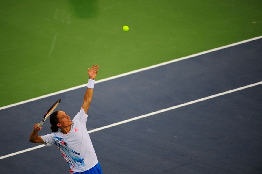 Alexandr Dolgopolov plays in the men's finals match against Tommy Haas and at the Citi Open tennis tournament at the William H.G. FitzGerald Tennis Center, Washington D.C., Sunday, August 5, 2012.  The match has been delayed several times due to rain.  (Ryan M.L. Young/The Washington Times)
