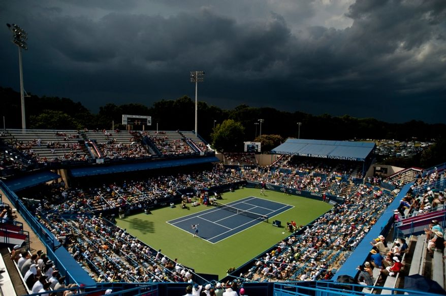 Storm clouds roll in during the men's finals match between Tommy Haas and Alexandr Dolgopolov at the Citi Open tennis tournament at the William H.G. FitzGerald Tennis Center, Washington D.C., Sunday, August 5, 2012.  The match has been delayed several times due to rain.  (Ryan M.L. Young/The Washington Times)