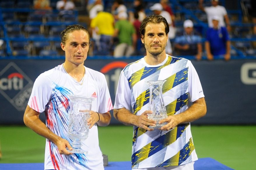 Alexandr Dolgopolov (left) and Tommy Haas (right) pose with the Citi Open tennis tournament trophies after playing in the men's final at the William H.G. FitzGerald Tennis Center, Washington D.C., Sunday, August 5, 2012.  Dolgopolov won the match in three games.  (Ryan M.L. Young/The Washington Times)