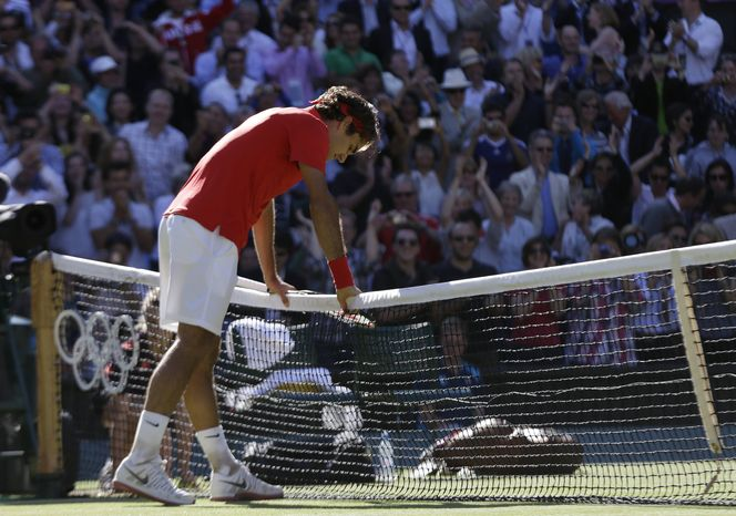 ** FILE ** Roger Federer of Switzerland leans on the net after he defeated Juan Martin del Potro of Argentina at the All England Lawn Tennis Club in Wimbledon, London at the 2012 Summer Olympics, Friday, Aug. 3, 2012. (AP Photo/Elise Amendola)