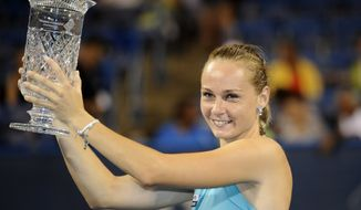 Magdalena Rybarikova, of Slovakia, poses with the trophy after she won the women's final in the Citi Open tennis tournament against Anastasia Pavlyuchenkova, of Russia, against , Saturday, Aug. 4, 2012, in Washington. Rybarikova won 6-1, 6-1. (AP Photo/Nick Wass)
