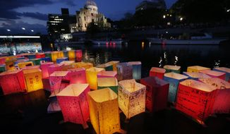 Paper lanterns float Aug. 6, 2012, along the Motoyasu River in front of the illuminated Atomic Bomb Dome in Hiroshima, Japan. Hiroshima marks the 67th anniversary of the atomic bombing on Aug 6. (Associated Press)
