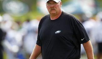 Philadelphia Eagles head coach Andy Reid watches a play during NFL football training camp at Lehigh University in Bethlehem, Pa., Monday, July 30, 2012. (AP Photo/Rich Schultz)