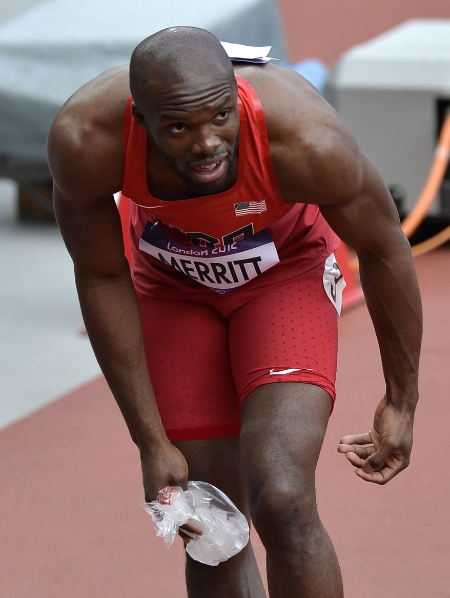 United States' LaShawn Merritt places ice onto his injured hamstring following his heat of the men's 400 meters during the athletics in the Olympic Stadium at the 2012 Summer Olympics, London, Saturday, Aug. 4, 2012. (AP Photo/Martin Meissner)