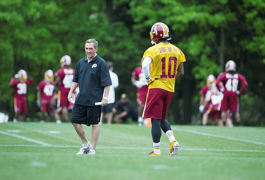 Redskins coach Mike Shanahan is hoping rookie quarterback Robert Griffin III learns from his mistakes in training camp. Griffin will make his debut in a Washington uniform when the Redskins open preseason Thursday against Buffalo. (Barbara L. Salisbury/The Washington Times)