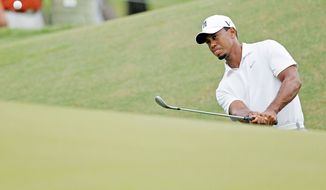 Tiger Woods watches his chip to the ninth green during a practice round for the PGA Championship golf tournament on the Ocean Course of the Kiawah Island Golf Club in Kiawah Island, S.C., Tuesday, Aug. 7, 2012. (AP Photo/Evan Vucci).(AP Photo/Evan Vucci)