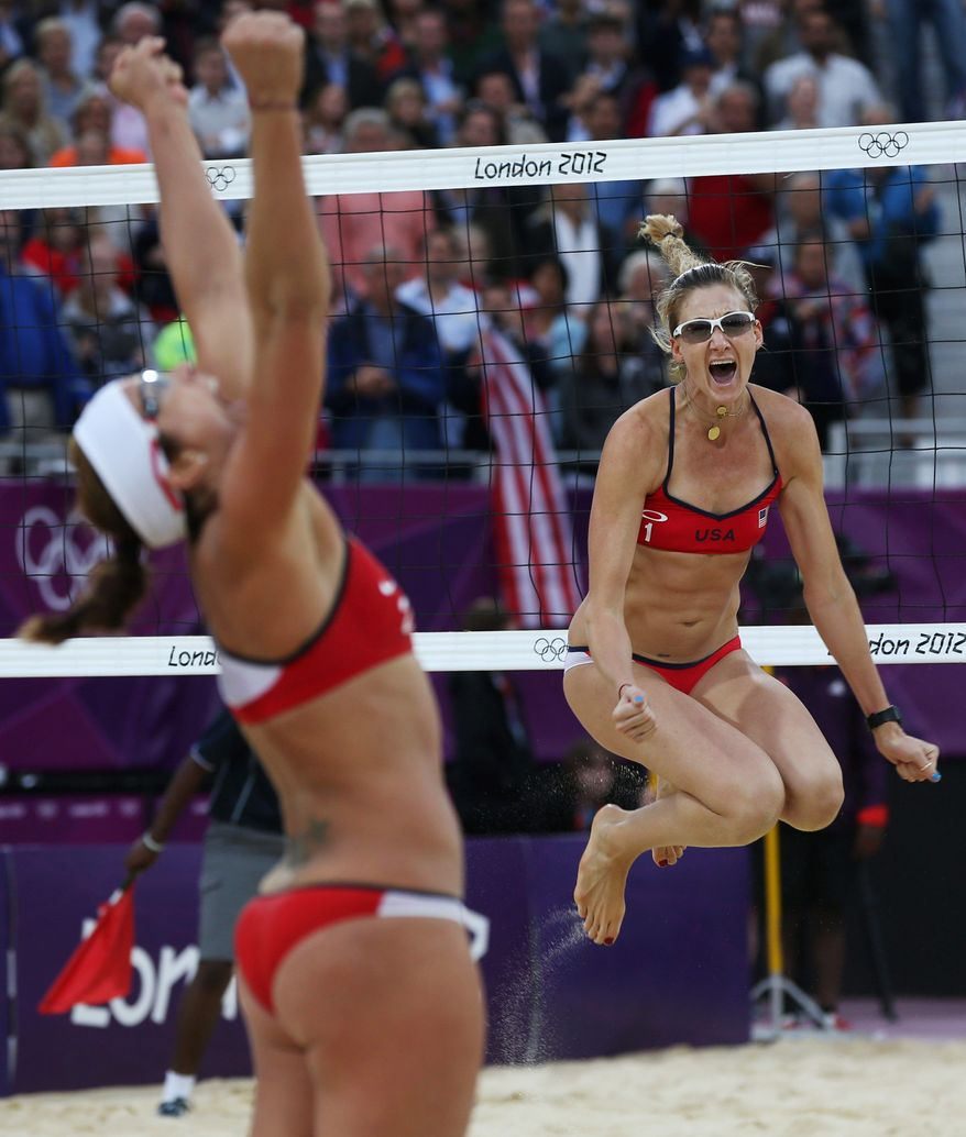 associated press  Misty May-Treanor and Kerri Walsh Jennings celebrate their win in the Olympic semifinals Tuesday. They will face fellow Americans April Ross and Jennifer Kessy in the gold medal match Wednesday.
