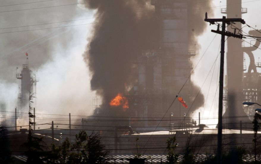 Smoke and flames shoot up Monday from a crude oil unit at the Chevron refinery in Richmond, Calif. The facility makes high-quality products that include gasoline, jet fuel, diesel fuel and lubricants, as well as chemicals used in manufacturing. (Associated Press)