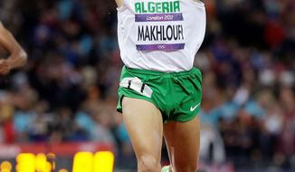 associated press  Taoufik Makhloufi celebrates his gold medal in the 1,500 meters Tuesday. The Algerian had been kicked out of the Olympics for not trying hard enough in another event, but he was reinstated when a doctor said he was injured.