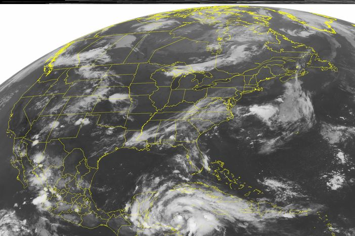 This NOAA satellite image taken Tuesday, Aug. 7, 2012, at 1:45 a,m, EDT shows a swirl of clouds in the western Caribbean Sea associated with Tropical Storm Ernesto as it approaches the Yucatan Peninsula. Ernesto is expected to strengthen into a hurricane being landfall just north of Belize late Tuesday evening. (AP PHOTO/WEATHER UNDERGROUND)
