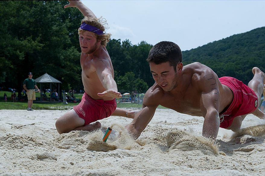 Jay Donoghue, left, of Greenbrier State Park and Michael Diambrosio, who guides for Assateague State Park, vie for the same flag during the beach flag portion of the 23rd annual Lifeguard Competition at Greenbrier State Park in Boonsboro, Md. on Tuesday, Aug. 7, 2012. The events included a 300-yard swim, beach flags, a rescue race, an iron guard relay and an obstacle course. The winners receive a trophy, but most importantly get bragging rights. (Barbara L. Salisbury/The Washington Times)