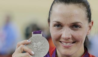Silver Medalist Victoria Pendleton, of Britain, poses shows her medal after the track cycling women's sprint event during the 2012 Summer Olympics in London, Tuesday, Aug. 7, 2012. (AP Photo/Christophe Ena)
