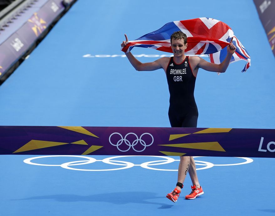 Great Britain's Alistair Brownlee reacts Aug. 7, 2012, as he crosses the finish line to win the gold medal in the men's triathlon at the 2012 Summer Olympics in London. (Associated Press)