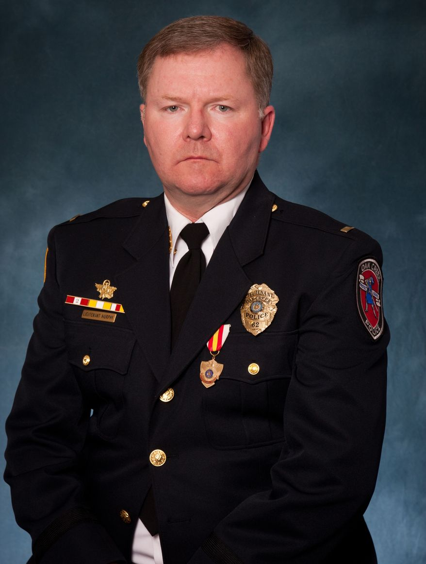 """This undated picture provided by the Oak Creek Police Department shows Lt. Brian Murphy. Murphy, 51, is a 21-year veteran with the Oak Creek Police Department. Police Chief John Edwards said the gunman in the Sikh temple shooting """"ambushed"""" Murphy, one of the first officers to arrive at the temple as the officer tended to a victim outside, shooting him eight to nine times with a handgun at close range. (AP Photo/Oak Creek Police Department)"""