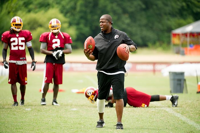 Washington Redskins defensive back coach Raheem Morris, center, runs a drill during afternoon practice at training camp at Redskins Park, Ashburn, Va., Tuesday, August 7, 2012. (Andrew Harnik/The Washington Times)