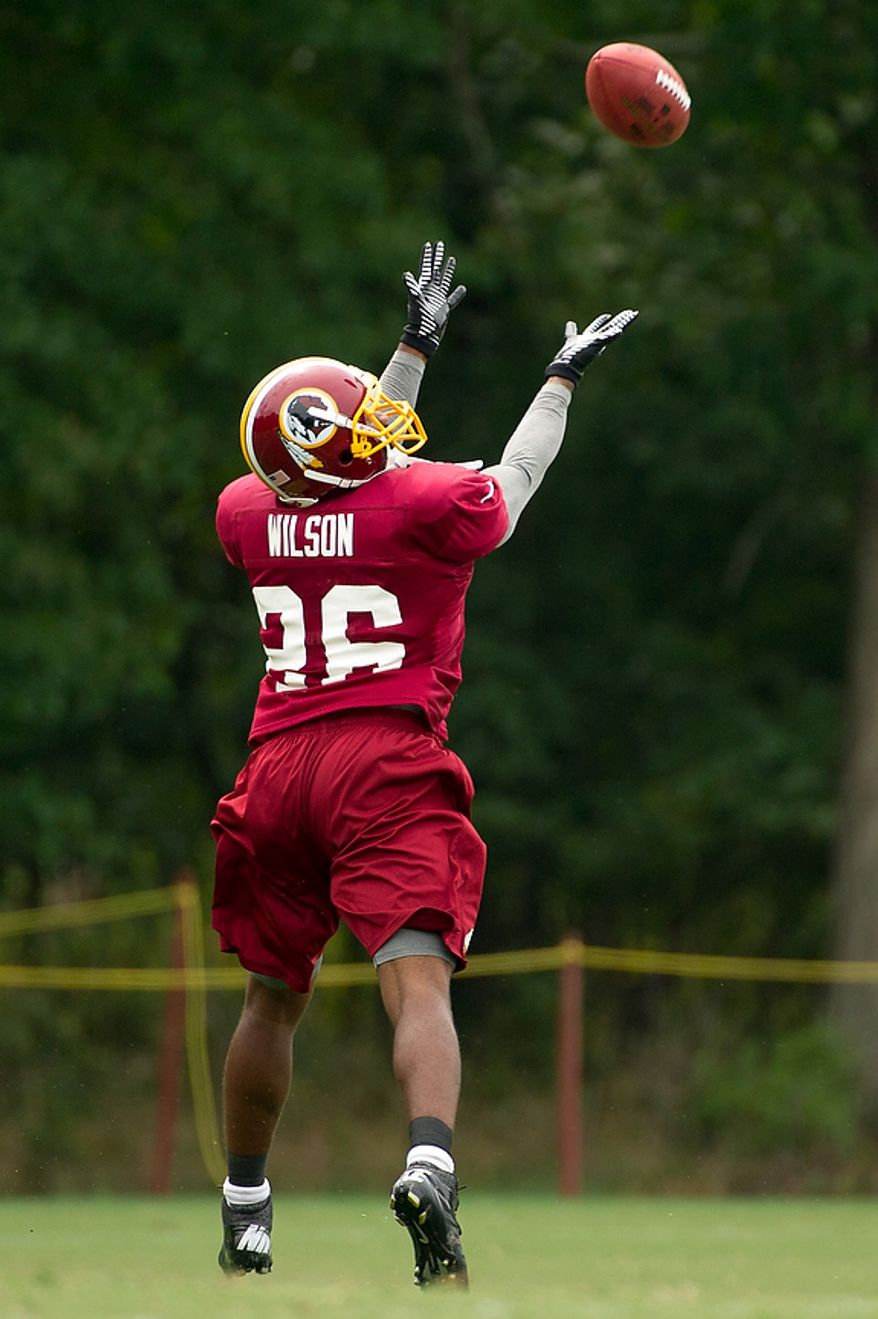 Washington Redskins defensive back Josh Wilson (26) goes back for a pass during afternoon practice at training camp at Redskins Park, Ashburn, Va., Tuesday, August 7, 2012. (Andrew Harnik/The Washington Times)