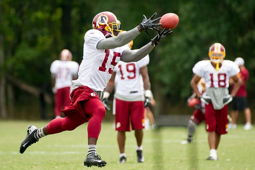 Washington Redskins wide receiver Josh Morgan (15) makes a catch during afternoon practice at training camp at Redskins Park, Ashburn, Va., Tuesday, August 7, 2012. (Andrew Harnik/The Washington Times)