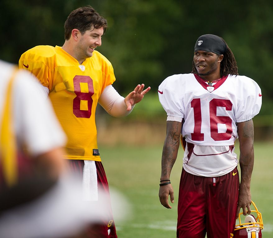 Washington Redskins quarterback Rex Grossman (8), left, and Washington Redskins wide receiver Brandon Banks (16), right, talk together following afternoon practice at training camp at Redskins Park, Ashburn, Va., Tuesday, August 7, 2012. (Andrew Harnik/The Washington Times)