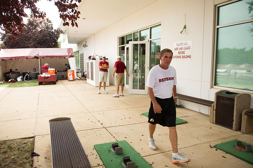 Washington Redskins head coach Mike Shanahan makes his way to a press conference following afternoon practice at training camp at Redskins Park, Ashburn, Va., Tuesday, August 7, 2012. (Andrew Harnik/The Washington Times)