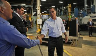 Republican presidential candidate Mitt Romney thanks Warren Young, chief executive officer at Acme Industries, as he campaigns in Elk Grove Village, Ill., on Aug. 7, 2012. (Associated Press)