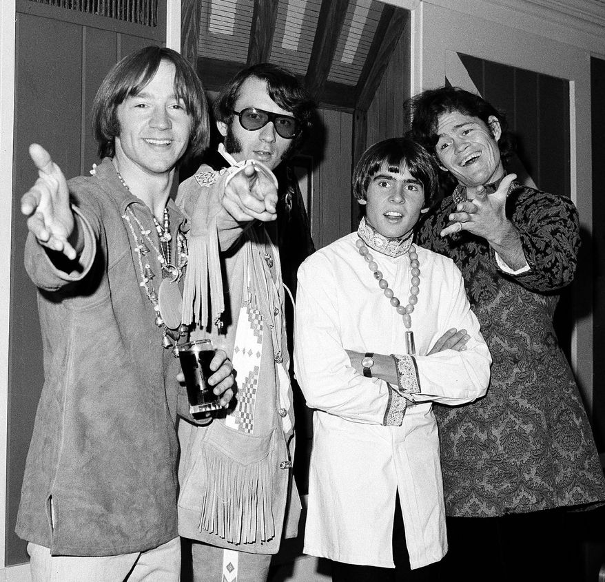 Monkees Peter Tork, Mike Nesmith (from left) and Micky Dolenz (far right) are reuniting for a tour. Davy Jones (second from right) died in February. (Associated Press)