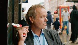 Author Martin Amis seems to reserve his trademark sneer for photo shoots. (Random House)
