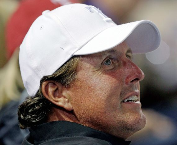 Phil Mickelson has qualified for every Ryder Cup and Presidents Cup team since 1995. (Associated Press)