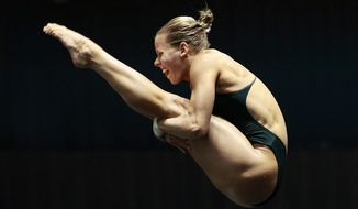 Brittany Viola dives in the women's 10-meter platform semifinals at the U.S. Olympic diving trials on Wednesday, June 20, 2012, in Federal Way, Wash. (AP Photo/Elaine Thompson)