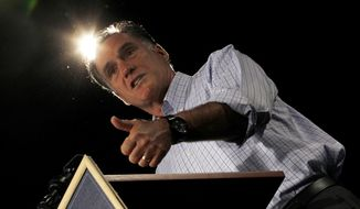 Republican presidential candidate Mitt Romney campaigns Aug. 8, 2012, at Central Campus High School in Des Moines, Iowa. (Associated Press)