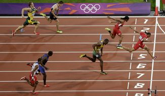 United States' Aries Merritt crosses the finish line to win the men's 110-meter hurdles final during the athletics in the Olympic Stadium at the 2012 Summer Olympics, London, Wednesday, Aug. 8, 2012. (AP Photo/Mark Baker)
