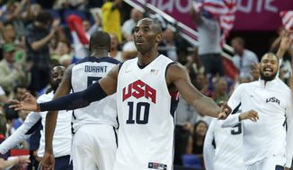 USA's Kobe Bryant celebrates a 3-pointer against Australia during a men's quarterfinals basketball game at the 2012 Summer Olympics, Wednesday, Aug. 8, 2012, in London. (AP Photo/Charles Krupa)