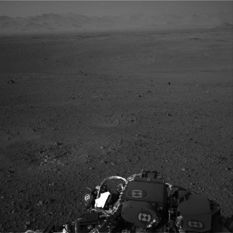 This image released by NASA on Wednesday, Aug. 8, 2012, and taken by cameras aboard the Curiosity rover shows the Martian horizon. (AP Photo/NASA)