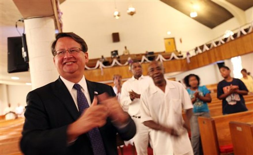 Democratic U.S. Rep. Gary Peters, left, campaigns for Michigan's new 14th district congressional seat at St. Paul A.M.E. Church in Detroit. (AP Photo/Detroit Free Press, Susan Tusa)