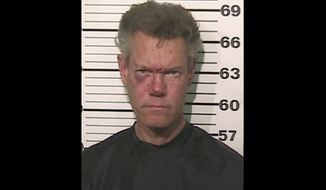 Country singer Randy Travis is pictured after being charged with driving while intoxicated near Tioga, Texas, late on Tuesday, Aug. 7, 2012. (AP Photo/Grayson County Sheriff's Office)
