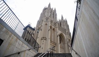 The Washington National Cathedral is viewed from the stairs leading up from its underground parking garage. Woodrow Wilson and his wife, Edith, are interred inside the cathedral, as are Helen Keller and Anne Sullivan. (Ryan M.L. Young/The Washington Times) ** FILE **