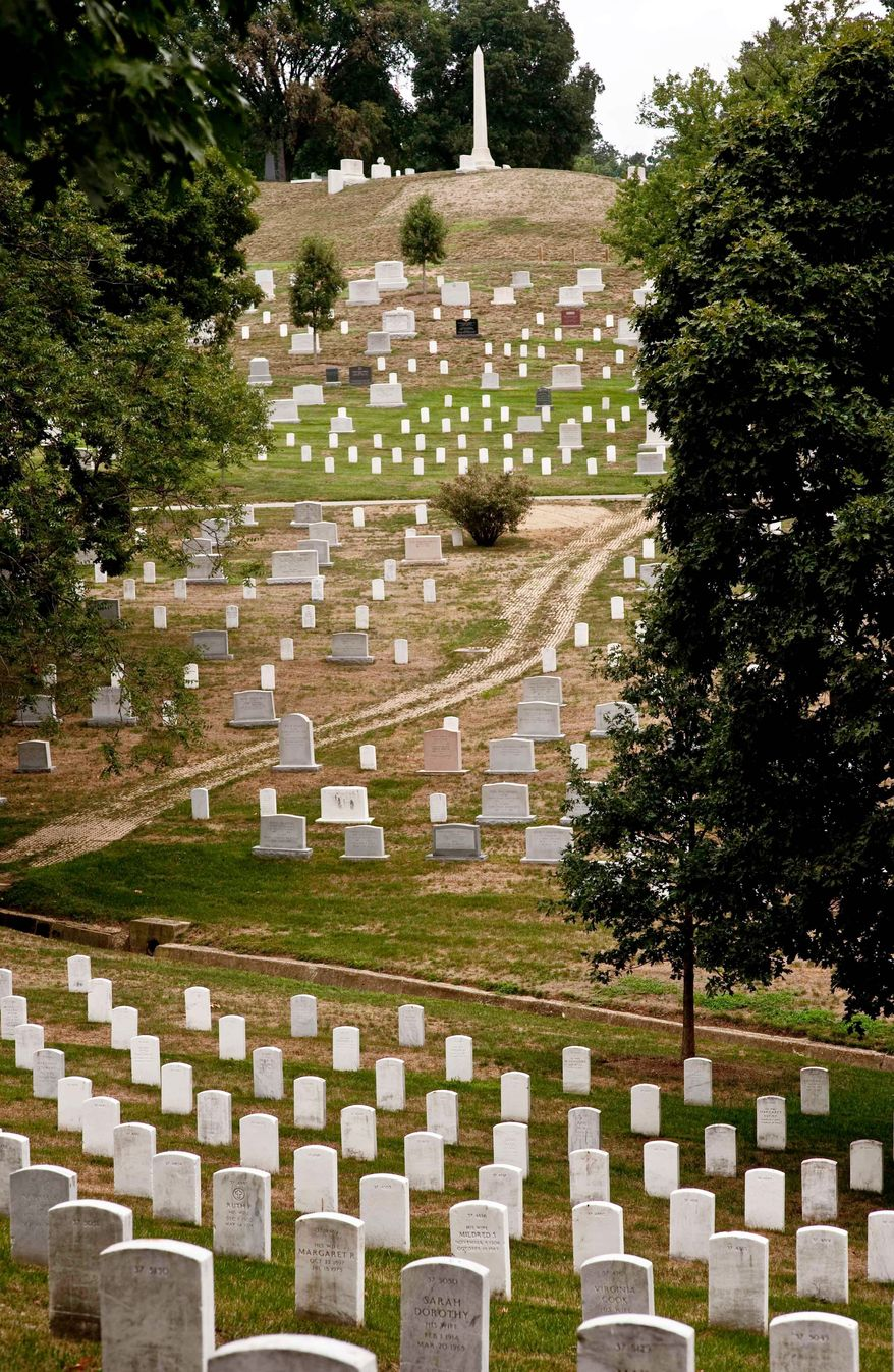 Row upon row of white marble monuments at Arlington National Cemetery honor military veterans. More than 400,000 graves line up on its 624 acres, which also hold the Tomb of the Unknowns and the grave of John F. Kennedy. (The Washington Times)