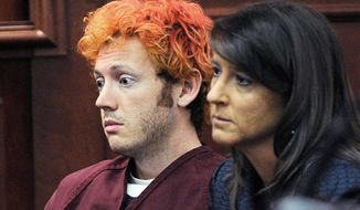 Defense attorneys for James Holmes, shown in a court appearance three days after the July 20 massacre in an Aurora, Colo., movie theater, said in a return to court Thursday that their client is mentally ill and that they need more time to assess the nature of his illness. (Associated Press)