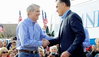 """Presumptive Republican presidential nominee Mitt Romney (right) is introduced by Sen. Rob Portman, Ohio Republican, at a rally in Charleston, S.C., in January. Mr. Portman's deep resume fills the """"heartbeat-away"""" requirement for a vice presidential prospect. (Associated Press)"""