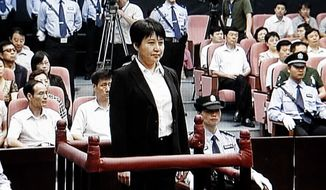 Gu Kailai (center), the wife of disgraced Chinese politician Bo Xilai, stands trial in the Intermediate People's Court in the eastern Chinese city of Hefei on Thursday, Aug. 9, 2012. (AP Photo/CCTV via APTN)