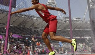 United States' Ashton Eaton performs in the discus throw Aug. 9, 2012, during the decathlon event in Olympic Stadium at the 2012 Summer Olympics in London. (Associated Press)