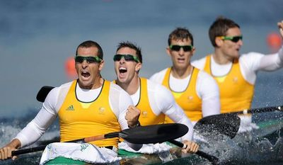 From left, Tate Smith, Dave Smith, Murray Stewart, and Jacob Clear of Australia celebrate winning the Gold medal in the men's kayak four 1000-meter sprint at Eton Dorney on Thursday, Aug 9, 2012 in Windsor, England. (AP Photo/Harry How, Pool)