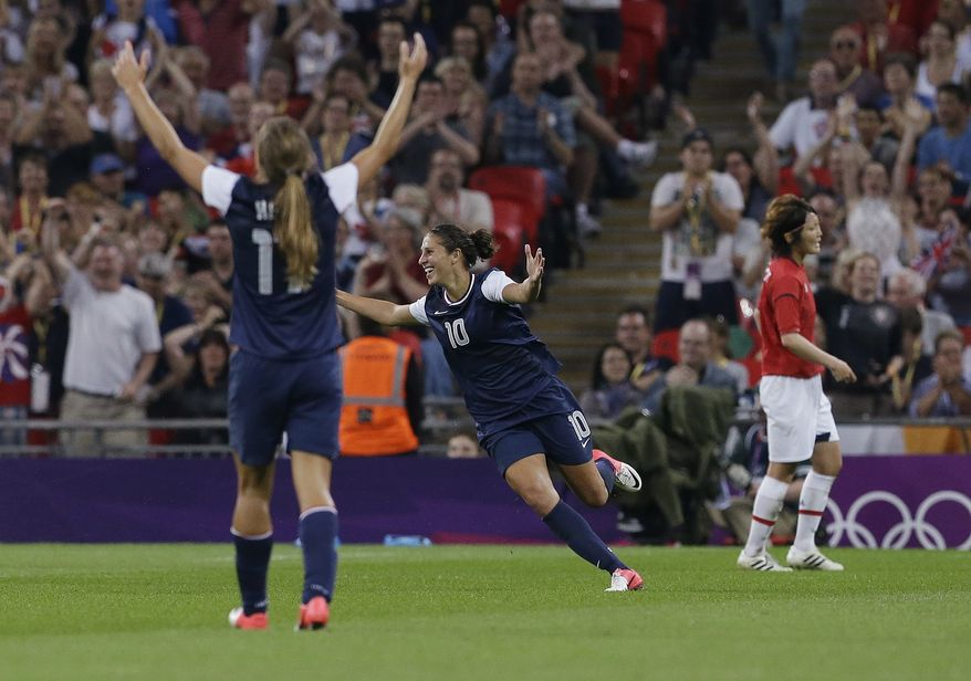 United States' Carli Lloyd (10) celebrates her goal with teammate Tobin Heath (17) during the women's soccer gold medal match against Japan at the 2012 Summer Olympics, Thursday, Aug. 9, 2012, in London. (AP Photo/Ben Curtis)