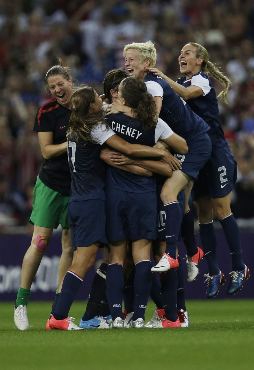 United States players celebrates winning the women's soccer gold medal match against Japan at the 2012 Summer Olympics, Thursday, Aug. 9, 2012, in London. (AP Photo/Lefteris Pitarakis)